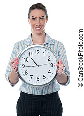 Business woman holding wall clock