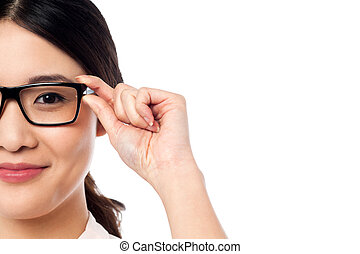 Pretty girl adjusting her spectacles - Young chinese girl...