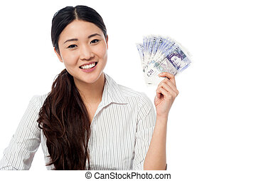 Pretty woman holding a fan of currency notes - Woman showing...