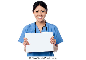 Physician holding blank white ad board
