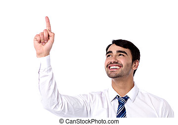 Happy businessman pointing upwards - Cheerful male executive...