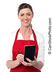 Attractive waitress taking order - Cheerful waitress writing...