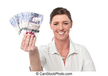 Business woman holding fan of currency notes - Woman showing...