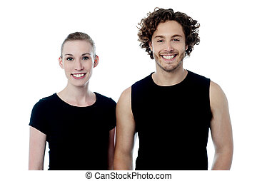 Smiling young couple in casuals