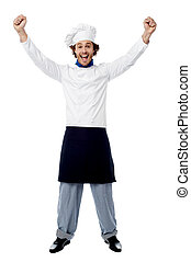 Wow! I won the contest - Excited young male chef over white...