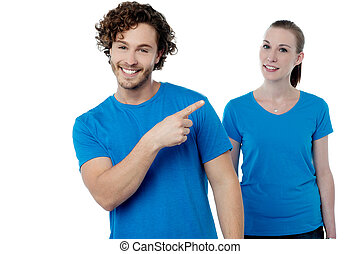 Casual couple over white background - Attractive young...