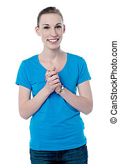 Happy young girl with clasped hands - Beautiful woman posing...