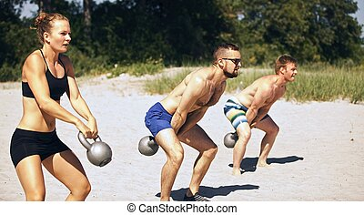 Crossfit Group Workout - Group doing crossfit workout on...