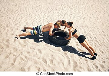 Crossfitters Doing Push-Ups - A group of crossfitters doing...