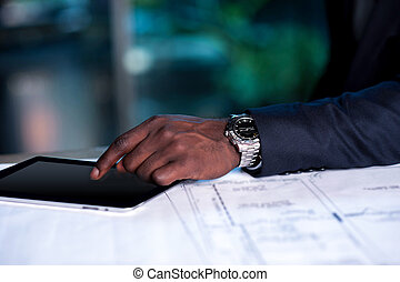 Man working on business development plan - Cropped image of...
