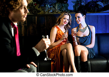 Flirtatious young girls staring at handsome guy - Charming...