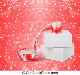 Gift boxes with red ribbons isolated on a white background