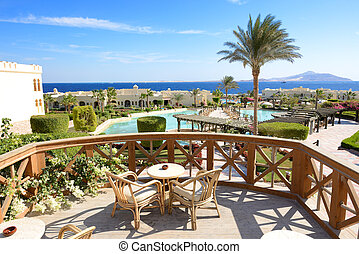 The view on swimming pool near outdoor restaurant at luxury hotel, Sharm el Sheikh, Egypt