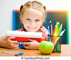 little girl at workplace with the books