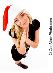top view of praying female wearing christmas hat on an...