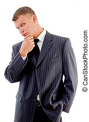 thinking businessman looking at camera on an isolated...