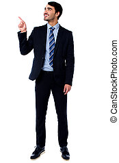 Businesssman pointing upwards - Business executive looking...