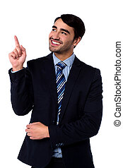 Businesss executive pointing upwards - Smiling corporate guy...