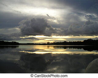 Sunset over Rio Negro in Brazil - Sunset over Rio Negro,...