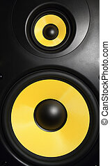 Speaker - Closeup of a yellow speaker sub woofer
