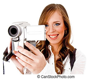 portrait of smiling female carrying video camera on an...