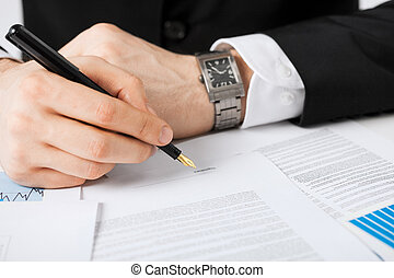 man with contract - close up picture of man hand signing...