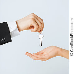 man and woman with house keys
