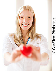 female doctor with heart - healthcare and medical concept -...