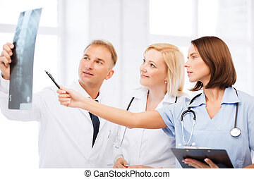 doctors looking at x-ray - healthcare, medical and radiology...