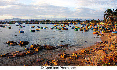 Many kind of ship anchoraged at fishing port on the sunset -...