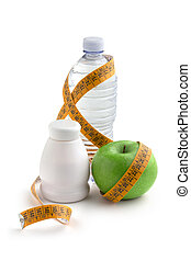 dietetic food - yogurt, apple and bottle of water wrapped by...