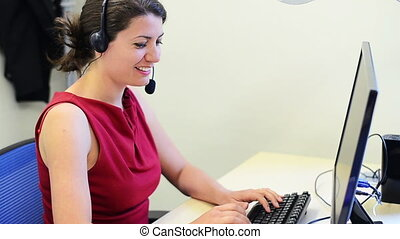 Female customer service representative at her desk