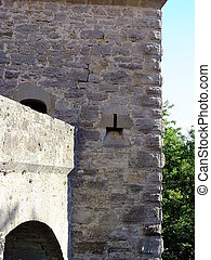 A historic tower with an embrasure