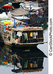 Houseboat refected on water surface - Houseboat attached on...