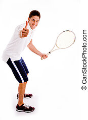 side view of tennis player with thumbs up against white...