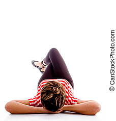 woman relaxing on floor lying down against white background