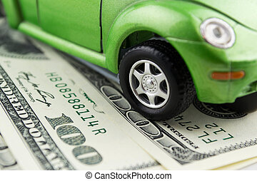 Toy car and money over white Rent, buy or insurance car...