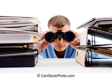 man with binocular searching and look between books - adult...