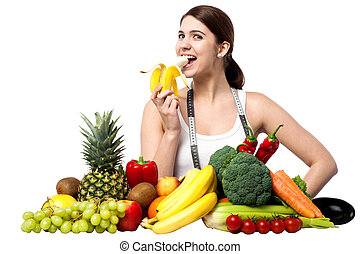 Healthy caucasian girl eating banana - Young girl with...