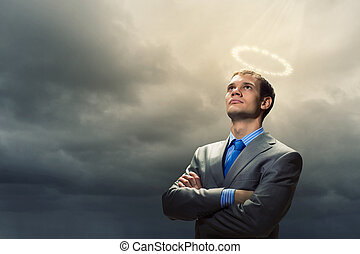 Saint businessman - Image of businessman with halo above...