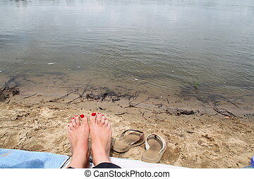 Painted toes by the Loire - Red painted toes by the shore of...