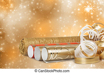 Rolls of multicolored wrapping paper for gifts with a...