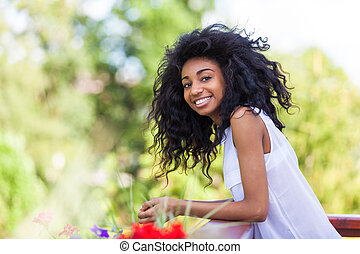 Outdoor portrait of a teenage black girl - African people -...