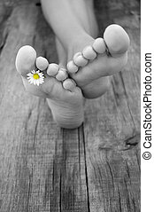 Barefoot - A person resting their feet on rustic old piece...