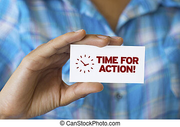 Time For Action - A person holding a white card with the...