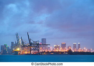 City of Miami Florida, colorful sunset panorama of downtown business buildings and the port