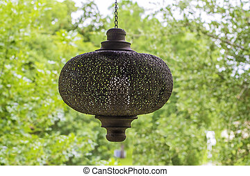 Porch Light - A vintage porch light hanging with a view of...