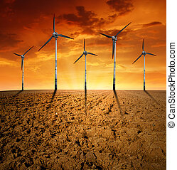 wind turbines - Spring field with wind turbines in the...
