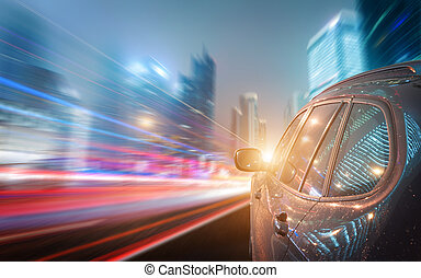 A car driving on a motorway at high speeds, overtaking other...