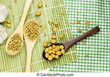 Sunflower seeds and nuts coated on spoon